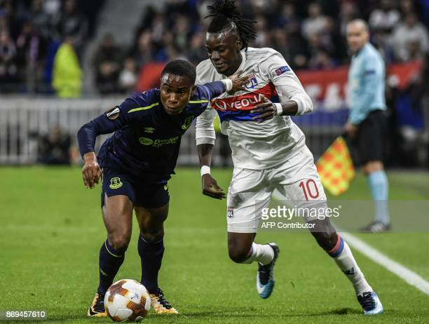 Everton's English striker Ademola Lookman vies with Lyon's Burkinabe forward Bertrand Traore during the Europa League football match Olympique...