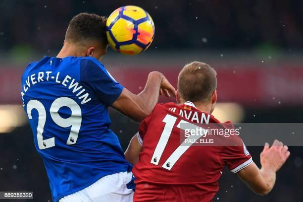 Everton's English striker Dominic CalvertLewin heads the ball ahead of Liverpool's Estonian defender Ragnar Klavan during the English Premier League...