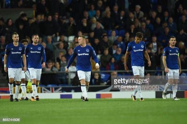 Everton's English striker Wayne Rooney and Everton players react to Apollon Limassol's Spanish defender Hector Yuste scoring his team's second goal...
