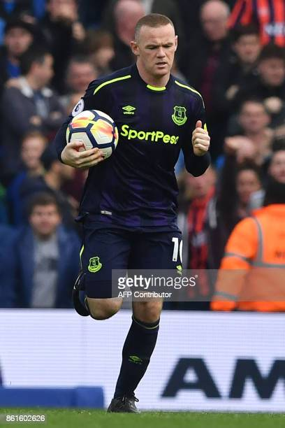 Everton's English striker Wayne Rooney celebrates scoring a penalty during the English Premier League football match between Brighton and Hove Albion...