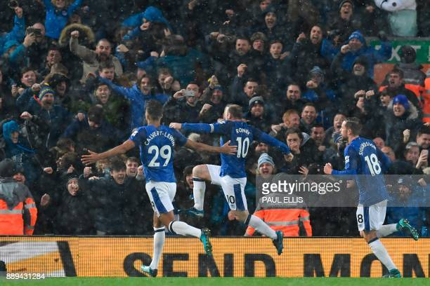 Everton's English striker Wayne Rooney celebrates scoring an equalising goal from the penalty spot to make the score 11 during the English Premier...