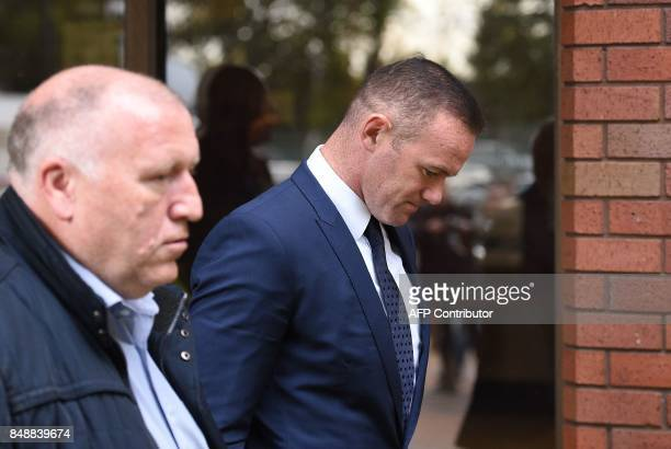 Everton's English striker Wayne Rooney leaves after attending Stockport Magsitrates Court in Stockport northwest England on September 18 2017 Former...