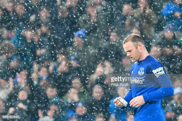 Everton's English striker Wayne Rooney leaves the pitch substituted during the English Premier League football match between Liverpool and Everton at...