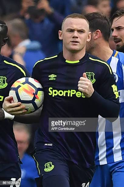Everton's English striker Wayne Rooney runs with the ball after scoring a penalty during the English Premier League football match between Brighton...
