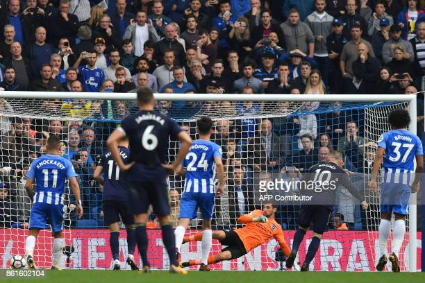 Everton's English striker Wayne Rooney scores a penalty during the English Premier League football match between Brighton and Hove Albion and Everton...