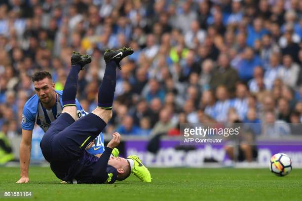 Everton's English striker Wayne Rooney takes a tumble with Brighton Irish defender Shane Duffy during the English Premier League football match...