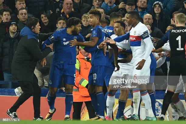 TOPSHOT Everton's Englishborn Welsh defender Ashley Williams is kept apart as players clash during the UEFA Europa League Group E match between...