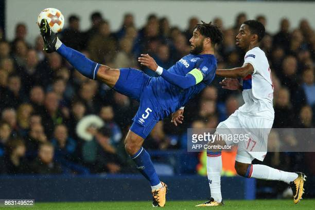 Everton's Englishborn Welsh defender Ashley Williams vies with Lyon's French striker Myziane Maolida during the UEFA Europa League Group E match...