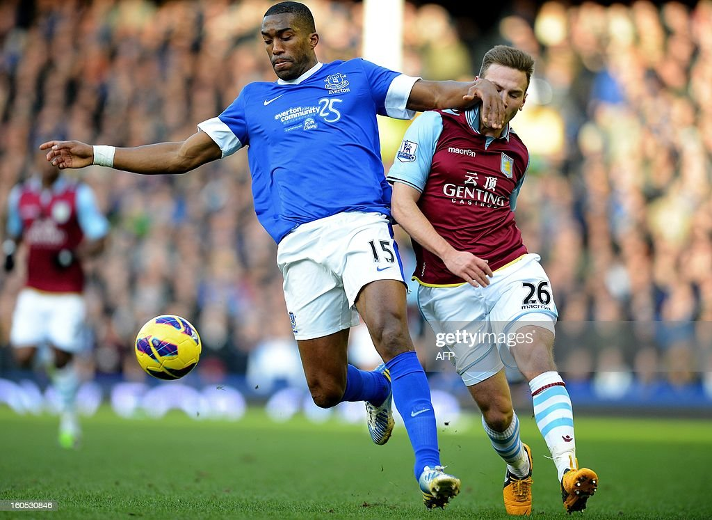 "Everton's French defender Sylvain Distin (L) vies with Aston Villa's Austrian forward Andreas Weimann during the English Premier league football match between Everton and Aston Villa at Goodison Park in Liverpool, north-west England on February 2, 2013. AFP PHOTO/ANDREW YATES RESTRICTED TO EDITORIAL USE. No use with unauthorized audio, video, data, fixture lists, club/league logos or ""live"" services. Online in-match use limited to 45 images, no video emulation. No use in betting, games or single club/league/player publications."