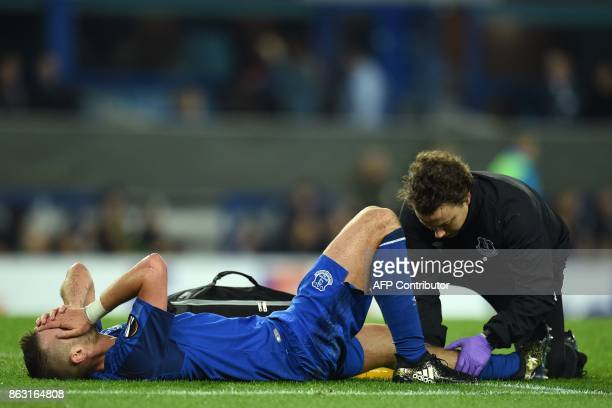 Everton's French midfielder Morgan Schneiderlin receives treatment on the pitch for an injury during the UEFA Europa League Group E match between...