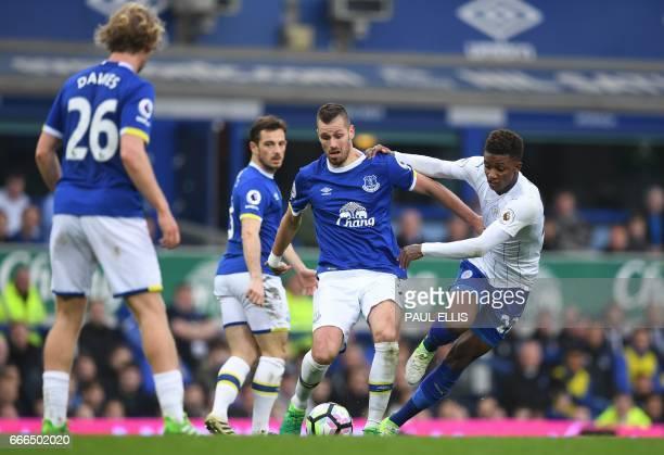 Everton's French midfielder Morgan Schneiderlin vies with Leicester City's English midfielder Demarai Gray during the English Premier League football...