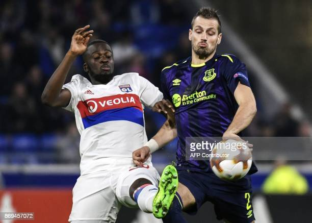 Everton's French midfielder Morgan Schneiderlin vies with Lyon's French midfielder Tanguy NDombele during the Europa League football match Olympique...