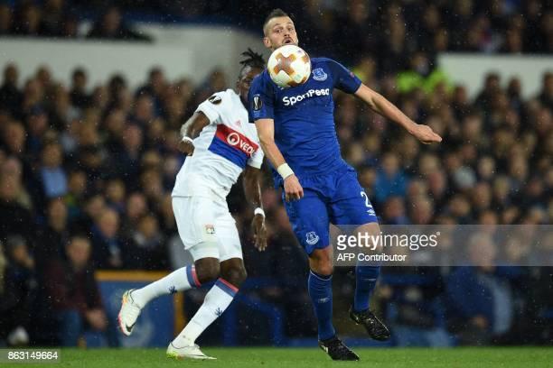 Everton's French midfielder Morgan Schneiderlin vies with Lyon's Burkinabe striker Bertrand Traore during the UEFA Europa League Group E match...