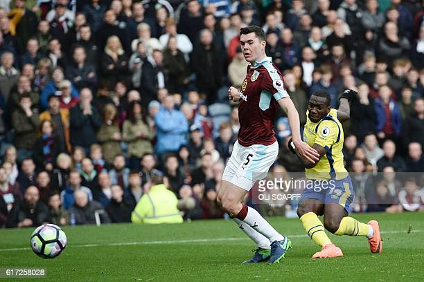 Everton's Frenchborn Congolese midfielder Yannick Bolasie shoots past Burnley's English defender Michael Keane to score their first goal to equalise...