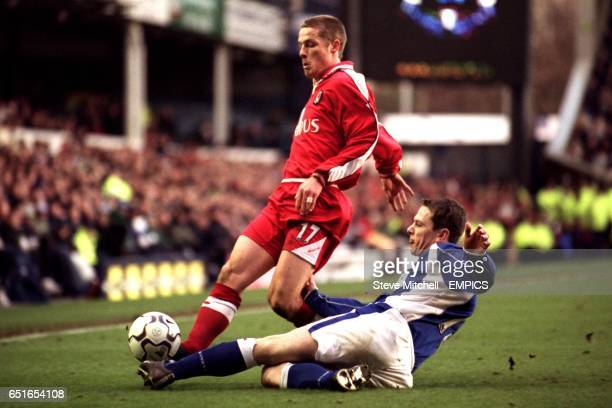 Everton's Gary Naysmith tackles Charlton Athletic's Scott Parker