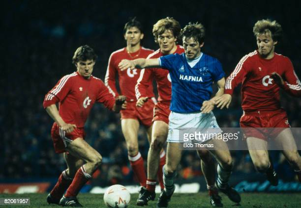 Everton's Gary Stevens is watched by Bayern Munich's Kogl Augenthaler Lerby and Pflugler during their European Cup Winners Cup SemiFinal 2nd leg at...