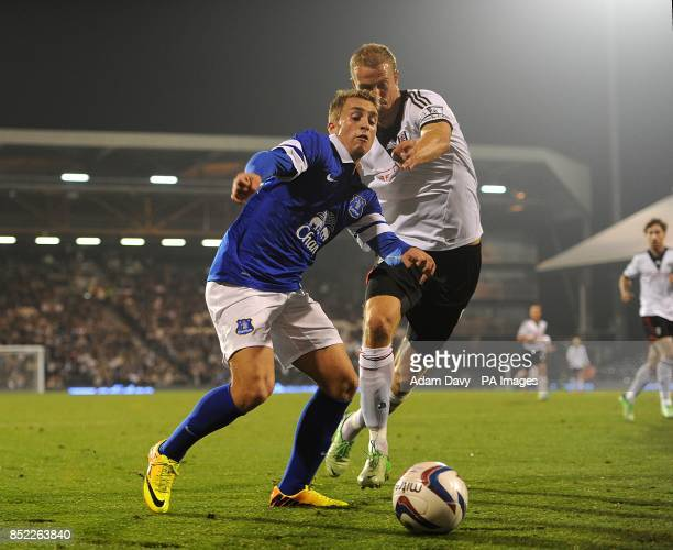 Everton's Gerard Deulofeu and Fulham's Brede Hangeland battle for the ball