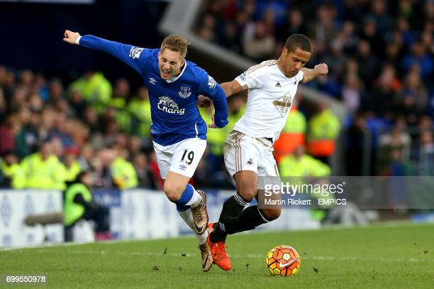 Everton's Gerard Deulofeu and Swansea's Wayne Routledge battle for the ball