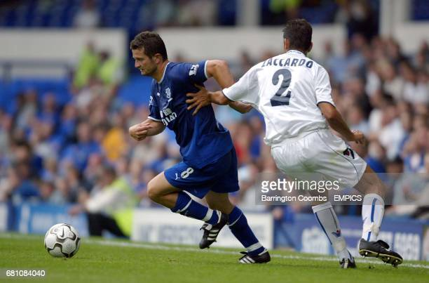 Everton's goal scorer Tomasz Radzinski gives Bologna's Christian Zaccardo the slip
