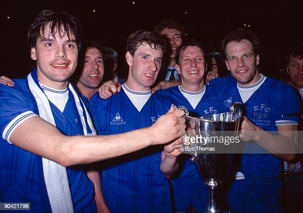 Everton's Graeme Sharp Kevin Sheedy Trevor Steven and Andy Gray celebrate with the trophy after the Everton v Rapid Vienna UEFA European Cup Winners...