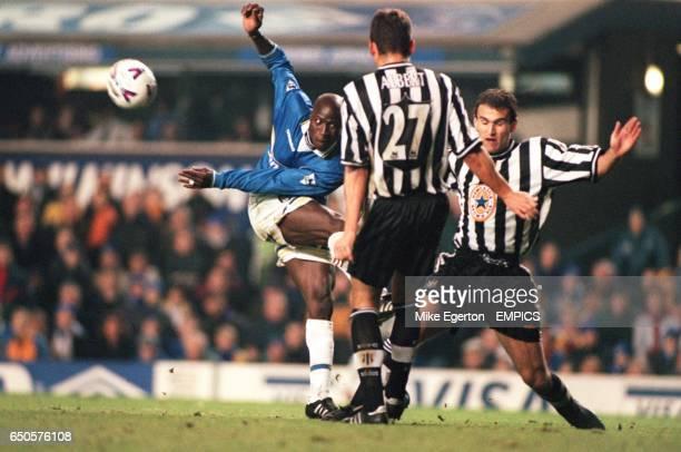 Everton's Ibrahima Bakayoko has his shot blocked by Newcastle United's Philippe Albert and Nikolaos Dabizas