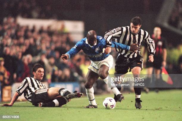 Everton's Ibrahima Bakayoko is tackled by Newcastle's Dietmar Hamann and Philippe Albert