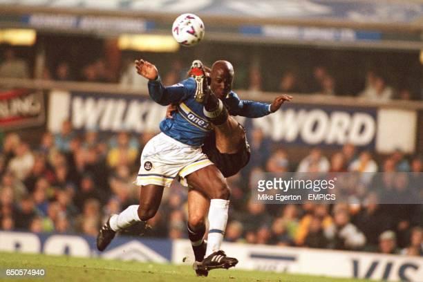 Everton's Ibrahima Bakayoko is tackled by Newcastle's Philippe Albert