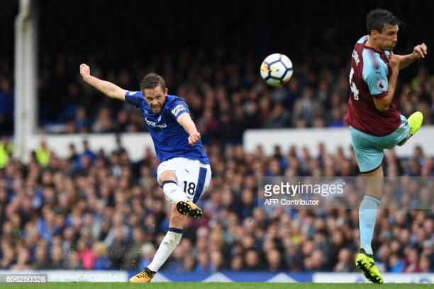 Everton's Icelandic midfielder Gylfi Sigurdsson has an unsuccessful shot during the English Premier League football match between Everton and Burnley...