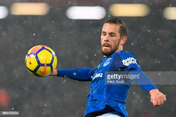Everton's Icelandic midfielder Gylfi Sigurdsson plays the ball during the English Premier League football match between Liverpool and Everton at...
