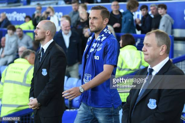 Everton's Icelandic midfielder Gylfi Sigurdsson walks aout to be introduced to supporters on the pitch ahead of the UEFA Europa League playoff round...