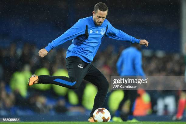 Everton's Icelandic midfielder Gylfi Sigurdsson warms up ahead of the UEFA Europa League Group E match between Everton and Lyon at Goodison Park in...