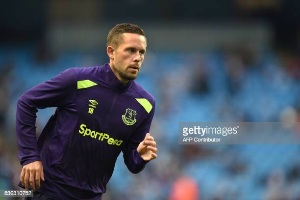Everton's Icelandic midfielder Gylfi Sigurdsson warms up prior to the English Premier League football match between Manchester City and Everton at...