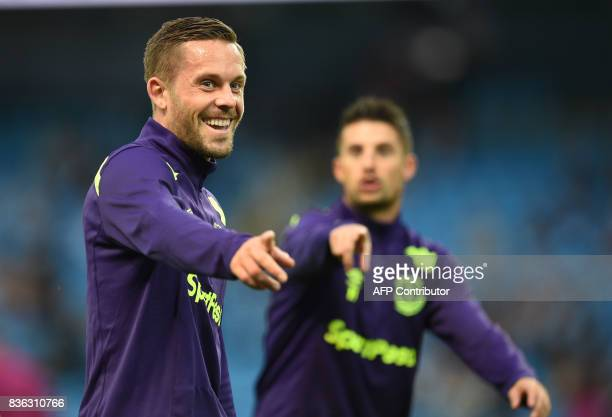 Everton's Icelandic midfielder Gylfi Sigurdsson warms up with Everton's Belgian striker Kevin Mirallas prior to the English Premier League football...