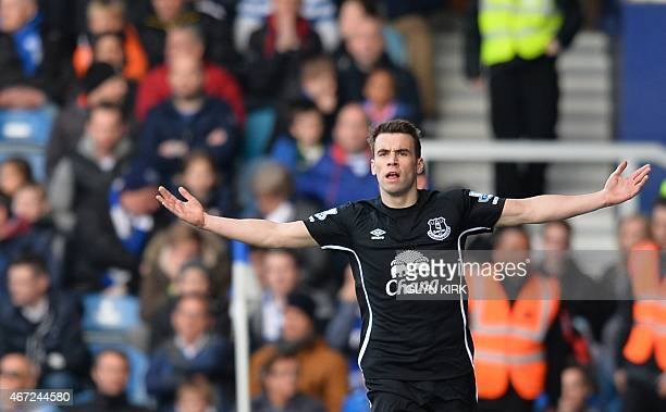Everton's Irish defender Seamus Coleman celebrates scoring the opening goal during the English Premier League football match between Queens Park...