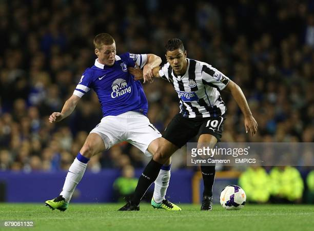 Everton's James McCarthy and Newcastle United's Hatem Ben Arfa battle for the ball