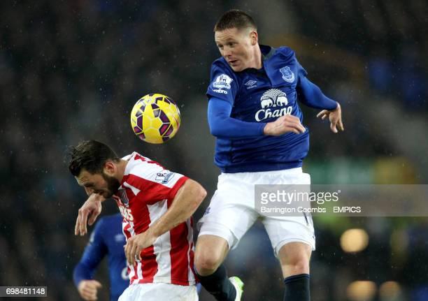 Everton's James McCarthy headers the ball above Stoke City's Erik Pieters