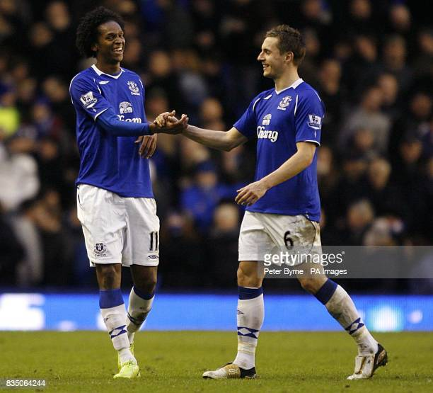 Everton's Joao Alves Jo celebrates with team mate Phil Jagielka after the final whistle