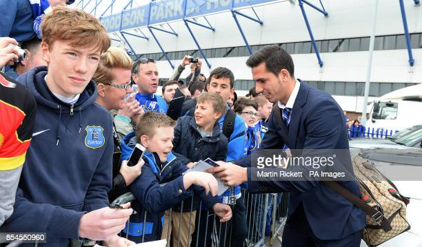 Everton's Joel Robles signs autographs for fans during the players parade