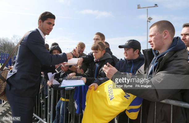 Everton's Joel Robles signs autographs for fans outside Goodison Park before the game