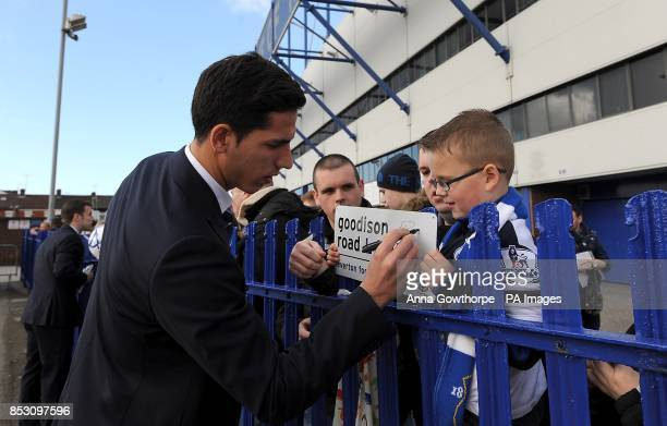 Everton's Joel Robles signs autographs outside the stadium