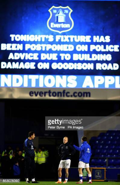 Everton's Joel Robles Steven Naismith and Leighton Baines training as the big screen informs fans that the game has been cancelled