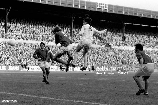 Everton's John Hurst and Henry Newton look on as teammate Keith Newton is beaten to a header by Leeds United's Allan Clarke
