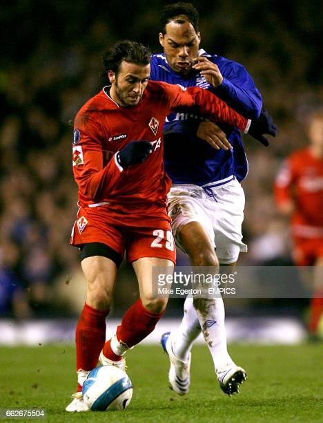 Everton's Joleon Lescott and Fiorentina's Giampaolo Pazzini battle for the ball