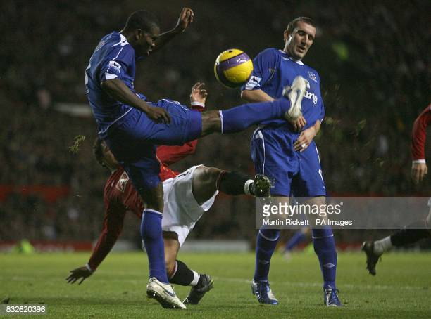 Everton's Joseph Yobo clears the ball away from Manchester United's Kieran Richardson as team mate Alan Stubbs watches on