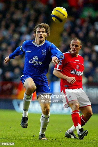 Everton's Kevin Kilbane chases the ball after eluding Charlton's Radostin Kishishev during their Premiership football match at the Valley in London...