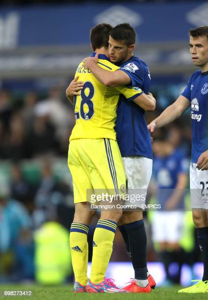 Everton's Kevin Mirallas and Chelsea's Cesar Azpilicueta hug after the final whistle