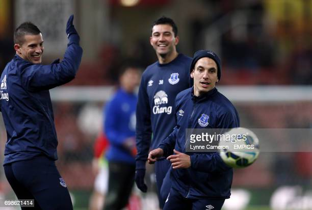 Everton's Kevin Mirallas Antolin Alcaraz and Leon Osman