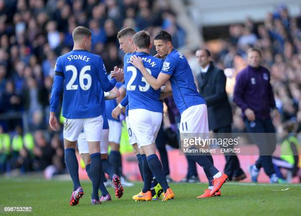 Everton's Kevin Mirallas celebrates scoring his sides third goal of the match with teammates