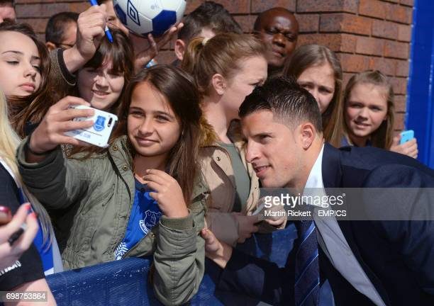 Everton's Kevin Mirallas poses for a photograph with fans outside Goodison Park