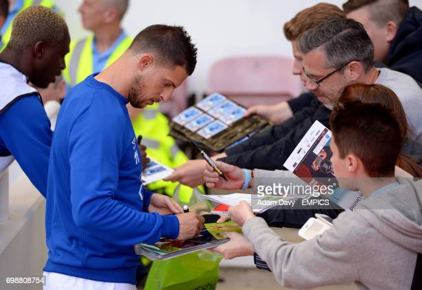 Everton's Kevin Mirallas signs autographs for fans before the game